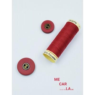 Botón rojo mate centro metal