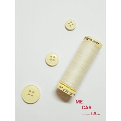Botón color marfil cuatro agujeros