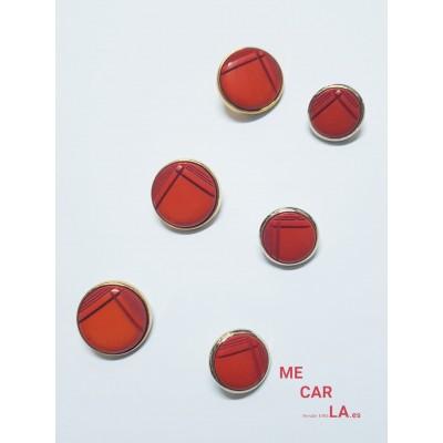 Botón fantasía color rojo con borde dorado