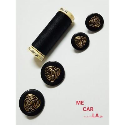 Botón fantasía negro y dorado
