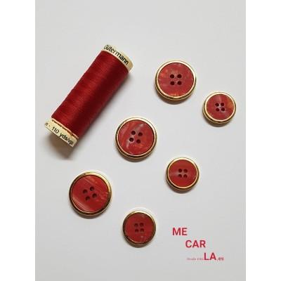Botón fantasía rojo matizado con borde dorado