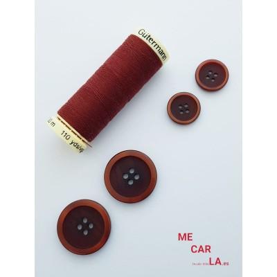 Botón clásico marrón matizado con borde